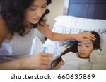 mother checking body... | Shutterstock . vector #660635869