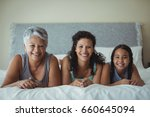 portrait of happy family lying... | Shutterstock . vector #660645094
