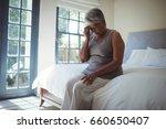 upset senior woman touching... | Shutterstock . vector #660650407