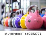 Colorful Kettlebells In A Row...