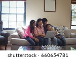 family using laptop together in ... | Shutterstock . vector #660654781