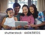 smiling family using digital... | Shutterstock . vector #660658531