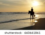 ride a horse at parangtritis... | Shutterstock . vector #660661861