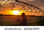 young handsome farmer with... | Shutterstock . vector #660665899