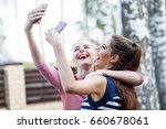 happy girls making fun and... | Shutterstock . vector #660678061