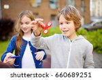 two funny friends playing with...   Shutterstock . vector #660689251