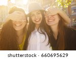 attractive young woman smiling... | Shutterstock . vector #660695629