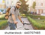 bearded mature male cyclist... | Shutterstock . vector #660707485