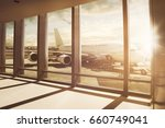 airplane stands at airport gate | Shutterstock . vector #660749041