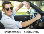 man with the keys to the car... | Shutterstock . vector #660823987
