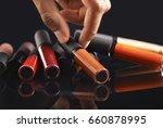 hand holding a liquid lipstick...   Shutterstock . vector #660878995