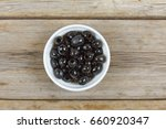 olives in a white bowl on a...   Shutterstock . vector #660920347