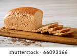 loaf of bread on breadboard - stock photo
