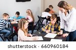 teacher and elementary age... | Shutterstock . vector #660960184