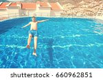 man in blue swimming trunks... | Shutterstock . vector #660962851