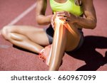 low section of female athlete... | Shutterstock . vector #660967099
