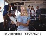 smiling businesswoman using... | Shutterstock . vector #660976249