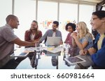 happy young business team... | Shutterstock . vector #660981664