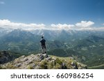 man on top of a mountain... | Shutterstock . vector #660986254