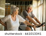 two senior people at the gym.... | Shutterstock . vector #661013341