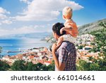 father and son on backgrounds... | Shutterstock . vector #661014661