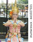 Small photo of Bangkok Thailand, March 2017-The traditional Thai dance troupe performs at Erawan Shrine. The four-faced Brahma (Phra Phrom) statue.