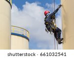male worker rope access ... | Shutterstock . vector #661032541