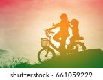 girl cyclists play in the... | Shutterstock . vector #661059229