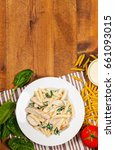 Small photo of Chicken Alfredo Pasta with Spinach. Selective focus.