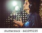 man singing in the studio | Shutterstock . vector #661095235