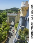 Small photo of SINTRA, PORTUGAL - MAY 23, 2017: View of one of the doors with oriental style and the access road to the Pena National Palace, from the highest walls
