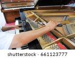 technician  tuning the piano   Shutterstock . vector #661123777