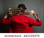 a saxophone players dark... | Shutterstock . vector #661133374
