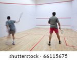 Squash Players In Action On A...