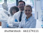 mix race scientists team happy... | Shutterstock . vector #661174111