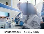 male scientist working with... | Shutterstock . vector #661174309
