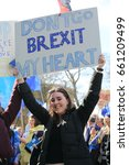 Small photo of Westminster, London, Uk. March 25, 2017 A young woman holds an anti-Brexit sign aloft at a Remain rally in march 2017. Brexit talks start this Monday, June 19, 2017.