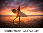 surfer running on the beach at... | Shutterstock . vector #661261039