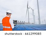 electrical engineers working at ... | Shutterstock . vector #661299085