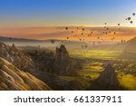 hot air balloon flying over... | Shutterstock . vector #661337911