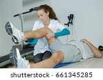 therapist stretching the... | Shutterstock . vector #661345285