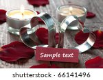 two hearts and candles with copy space - stock photo