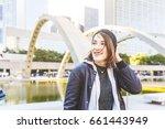 happy girl portrait in the city.... | Shutterstock . vector #661443949