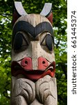 Painted Wooden Totem Pole In...