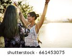 girl friends taking photo music ... | Shutterstock . vector #661453075