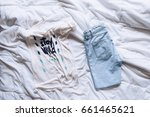 female outfit laid out on bed ... | Shutterstock . vector #661465621