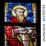 Small photo of GHENT, BELGIUM - DECEMBER 23, 2016: Stained Glass window depicting Saint Jerome in the Cathedral of Saint Bavo in Ghent, Flanders, Belgium.