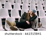 Stock photo young hipster girl with her pet estonian hound dog playing and having fun outdoor in the park 661515841