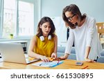 two women working together at... | Shutterstock . vector #661530895