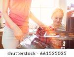 smiling looking at mother... | Shutterstock . vector #661535035